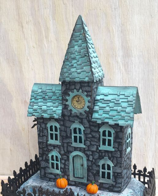 Stone Stencil Clock House - Halloween house with a stone-like surface and shingled roof #putzhouse #halloween #papercraft