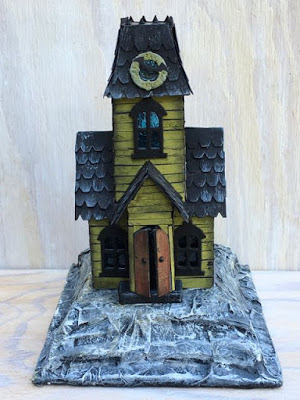 Little cardboard Putz house made from Tim Holtz Village Manor die as a Halloween house #putzhouse #halloweenhouse #timholtz #villagemanor