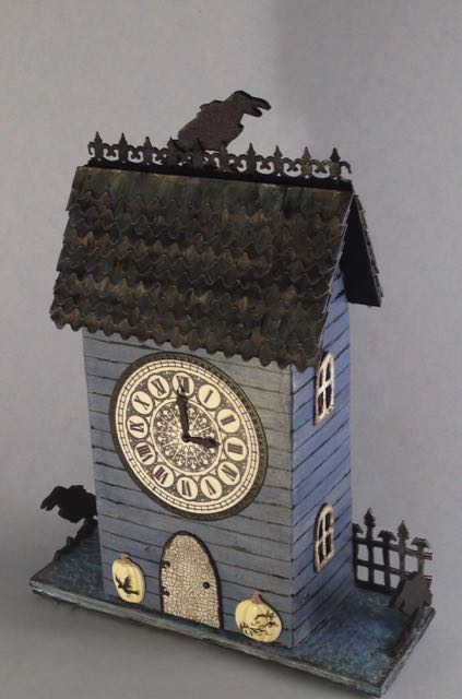 Raven's Crest Clock House - a paper-based house to hang on your wall for Halloween #putzhouse #halloween #papercraft #wallhanging