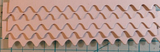 Staggered shingles for paper houses
