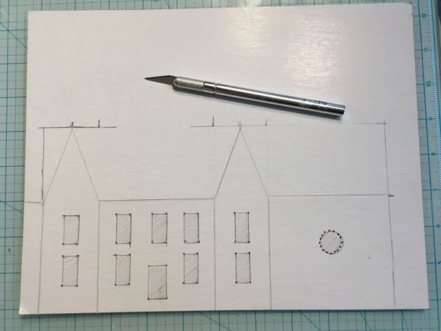 Mark the corners of your windows and doors on your putz house with a push pin #putzhouse #paper #craft