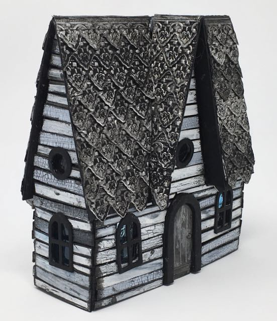Crackled paint siding and embossed roof shingles provide lots of texture and interest on this Halloween Paper House #halloween #putzhouse #papercraft