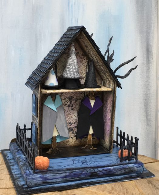 Hilda's Haberdashery miniature paper Halloween house with capes and witch hats for sale