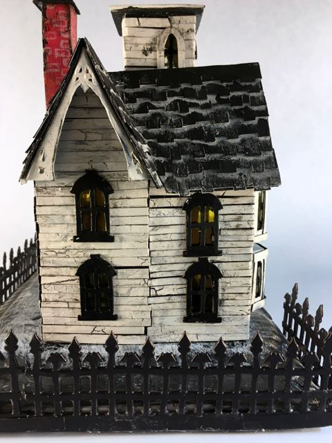 Halloween house with hand cut cardboard trim to mimic the Italianate trim #halloweenhouse # halloween #putzhouse #papercraft