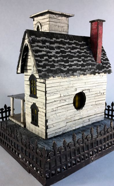 Italianate Halloween House back view with the light hole and the crackled siding #halloweenhouse #halloween #putzhouse #papercraft