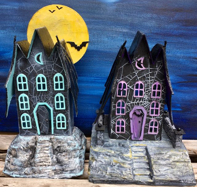 Bat Wing Halloween House called the Count's Keep where spooky Count Dracula is waiting in the doorway #halloweenhouse #putzhouse #halloween #papercraft