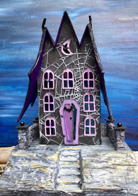 The Count's Keep Spooky Halloween Paper House with bat wings on each side, bats flying around the windows and the Count in the doorway #halloweenhouse #putzhouse #halloween #papercraft