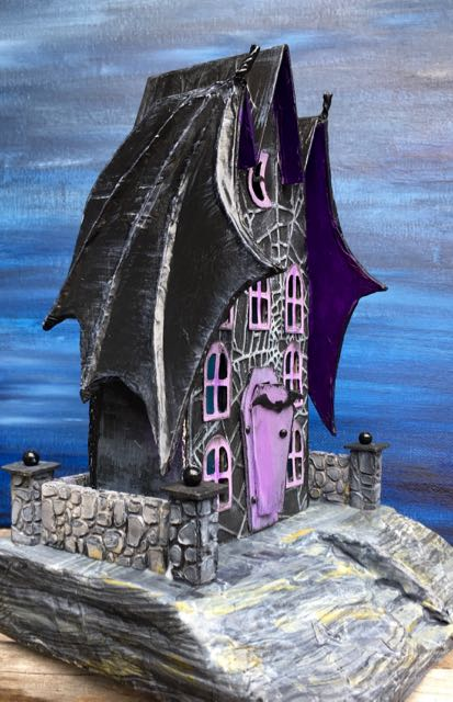 Bat Wing Halloween paper house showing the inset stairs and surrounding stone wall #halloweenhouse #putzhouse #halloween #papercraft