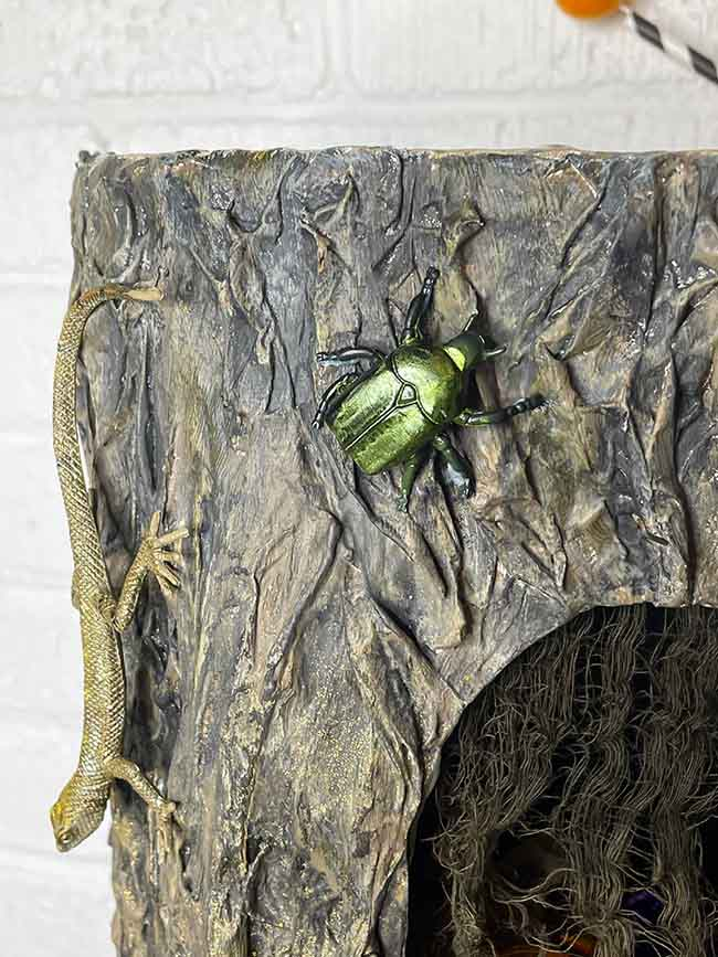 Iridescent plastic beetle with made with alcohol pearls