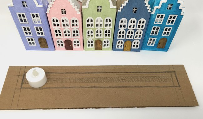 LED light fits on cardboard base for Amsterdam canal putz houses