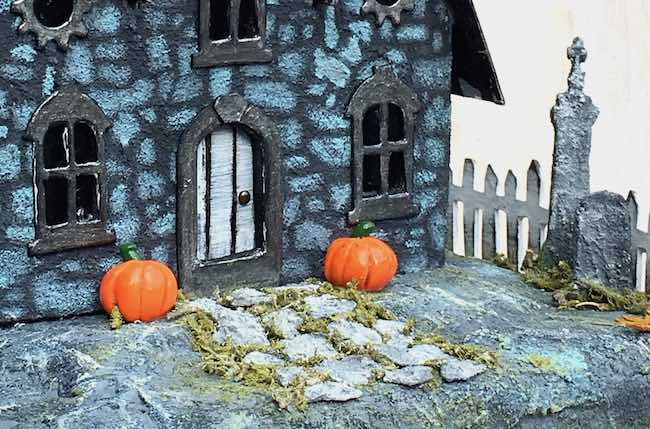Landscaping stones on Jeremiah's Halloween paper house