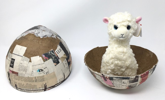 Large paper mache egg with llama test fit