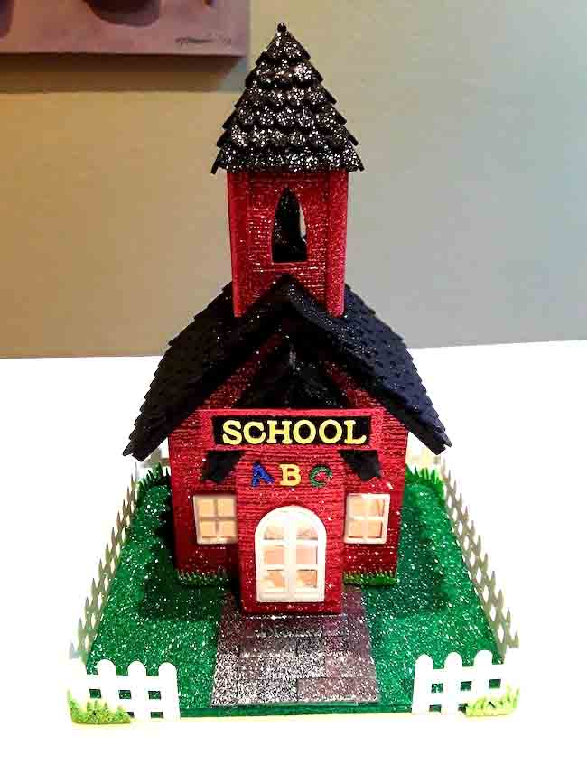 Paper schoolhouse with ABC school sign