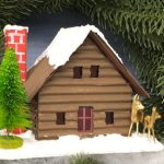 Log cabin putz house angled with deer bottlebrush tree