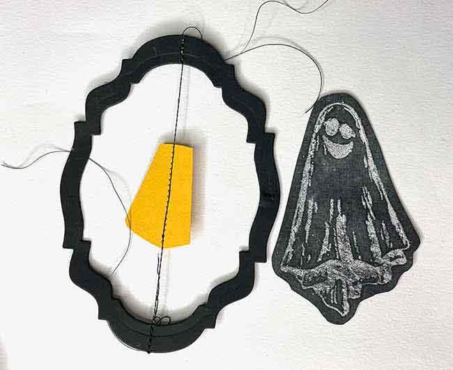 Make center spinning piece for chalkboard Halloween ornament smaller