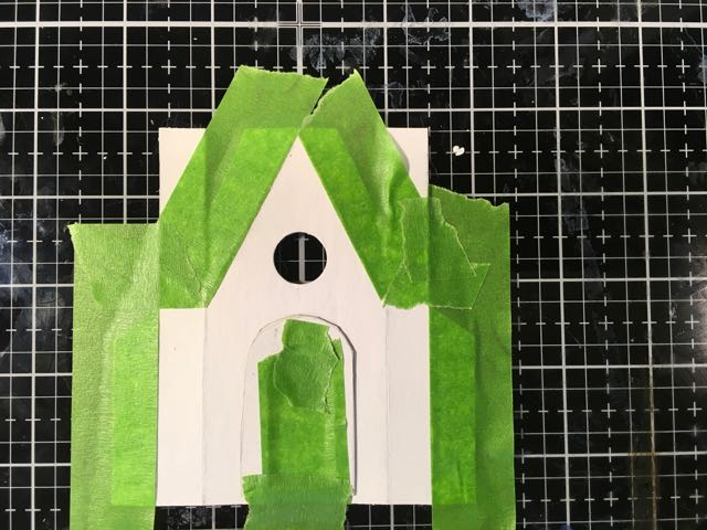 Masking areas before applying texture paste to the stone for the Halloween house