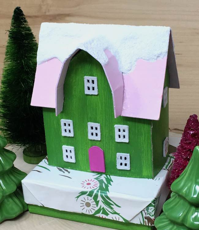 Miniature Christmas house on gift box