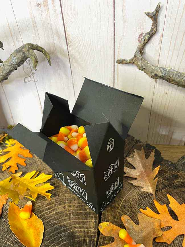 Miniature cardstock Halloween house candy box with candy corn inside