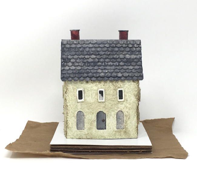 Coarse textured mini putz house on cardboard base