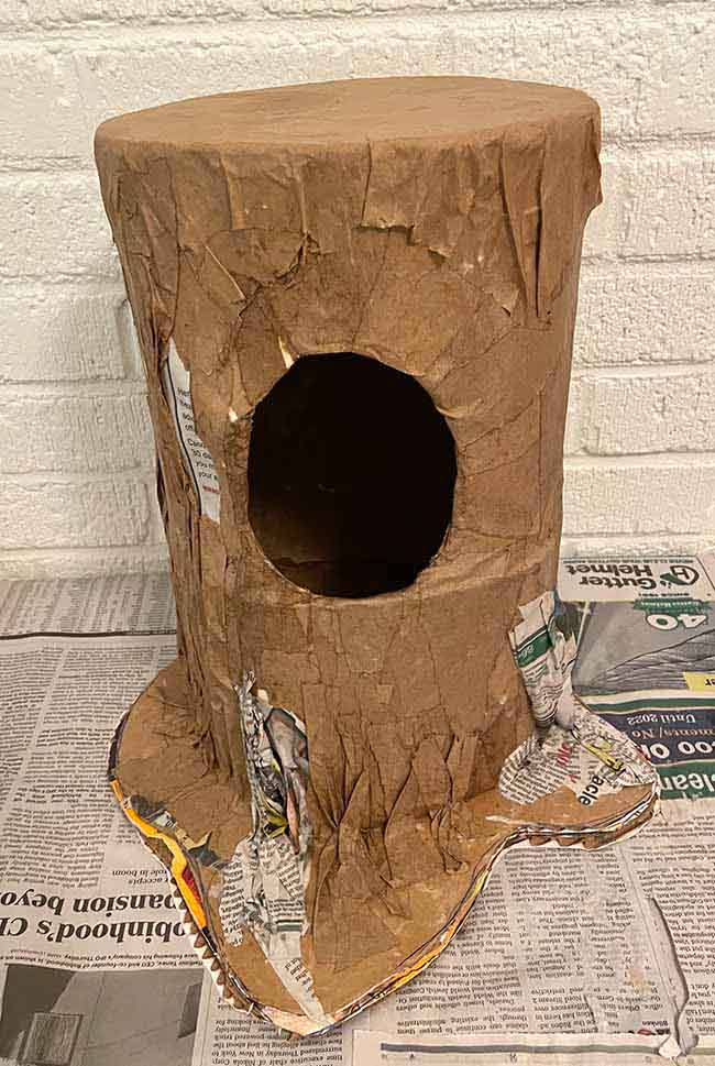 Outside first layer of paper mache for tree stump