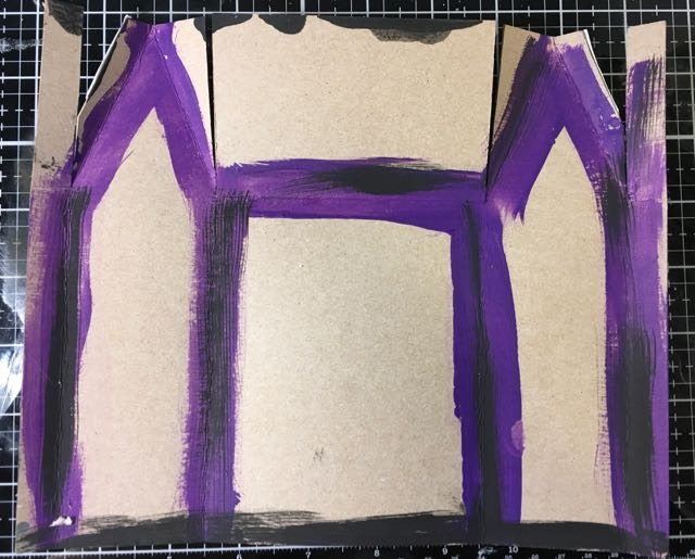 Paint the area around the fold lines so cardboard won't peak through
