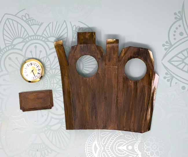 Painted clock pieces to mimic wood grain