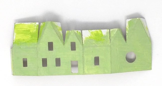 Painted miniature irish paper house structure before gluing together