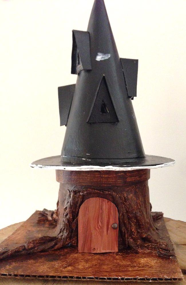 Painted tree stump base Black Hat Inn