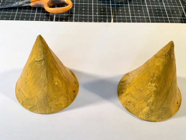 Painting the cones for the leafy top tree stump paper houses