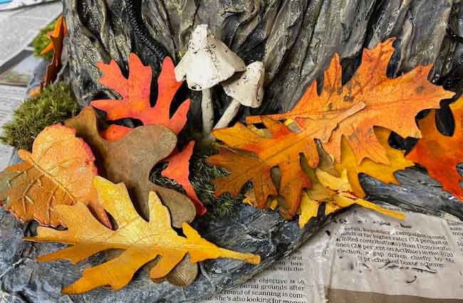 Paper leaves at base of paper mache tree stump