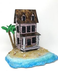 Little putz house by the sea with palm trees