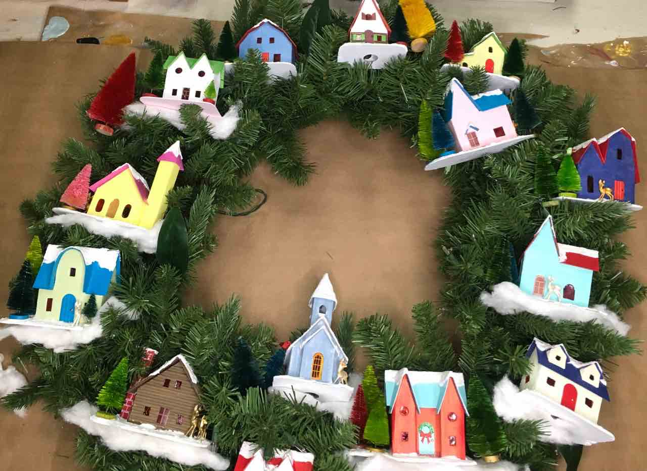 Place the putz houses where you would like them to be on your snow village wreath