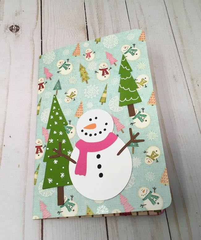 Pop-up card with little cottage and and snowmen on front