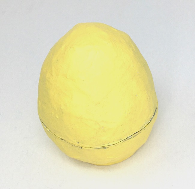 Primed and painted yellow paper mache egg