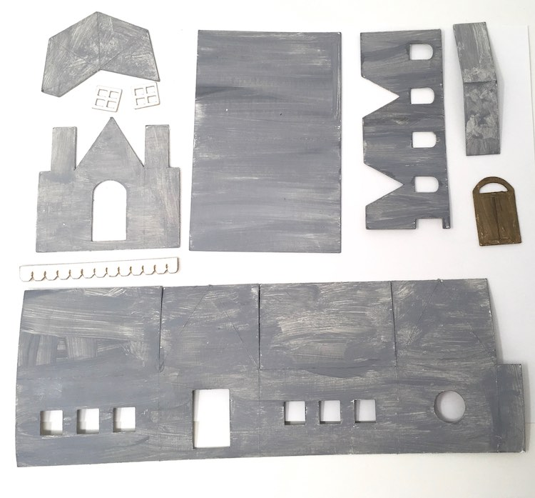 Primed cardboard for paper school house