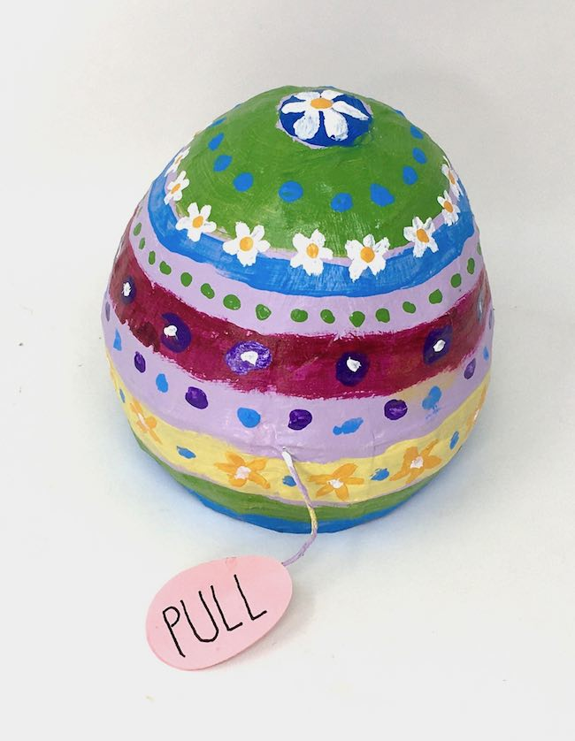 Primitive painted paper mache egg