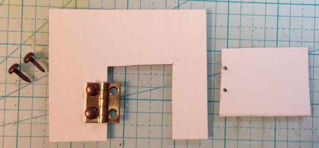 Prototype Putz door with one edge of hinge anchored