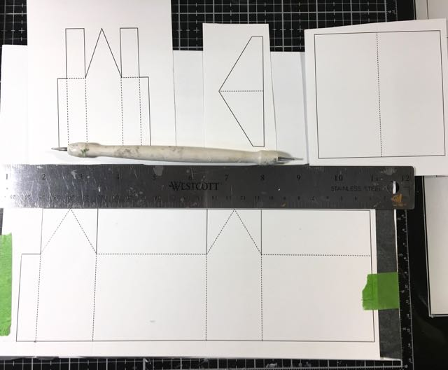 Putz house pattern template taped to cardboard tracing paper