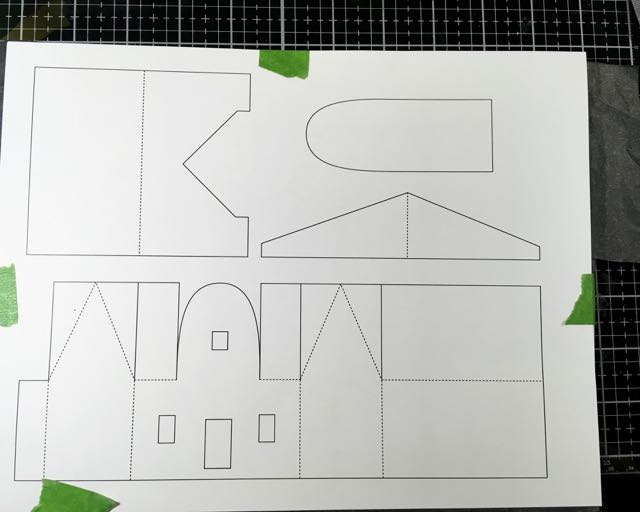 Round arch front cardboard putz house pattern taped to cardboard tracing paper