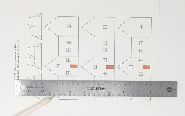 Score the dotted lines on paper pattern before cutting #popuphouse #paperpattern #papercraft
