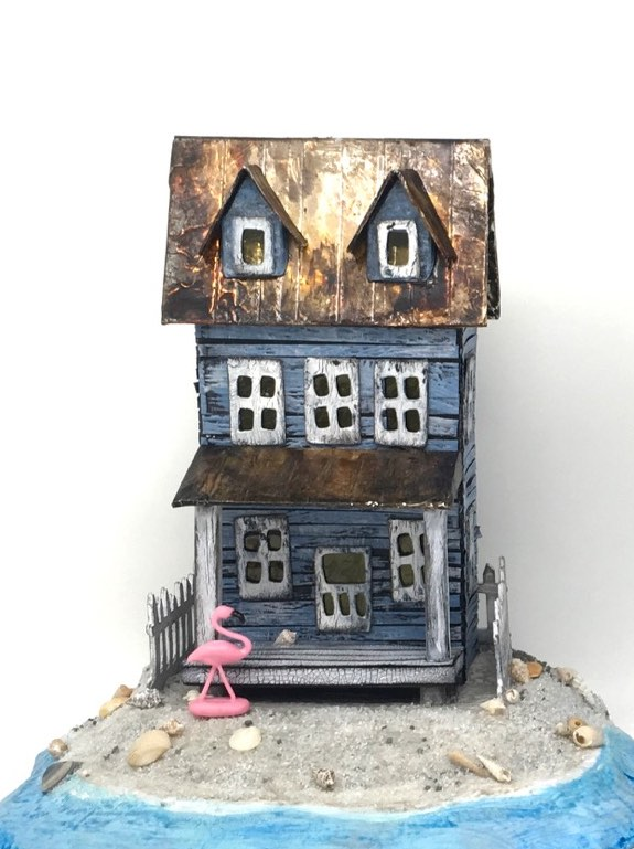 Sea-Worn Beach Putz House with Pink Flamingo