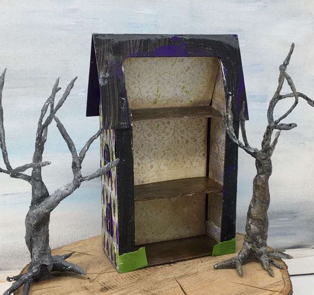 Shelves glued in place to hold the miniature two-sided Halloween house together