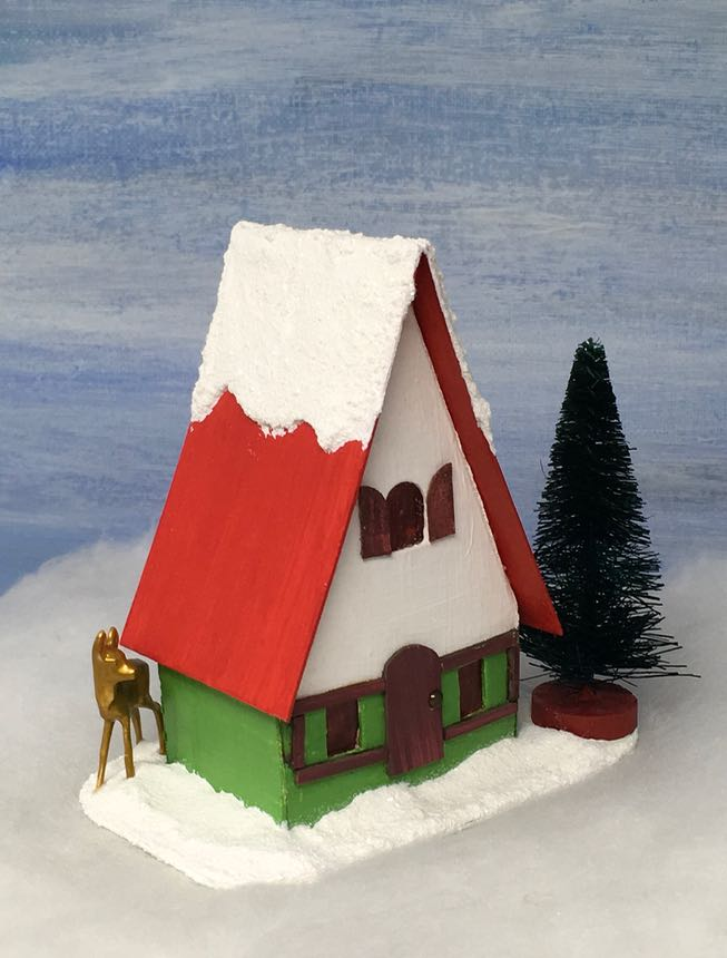 Side view of the Swiss Chalet Christmas Putz house - a little easy to make cardboard house made for a Christmas village.