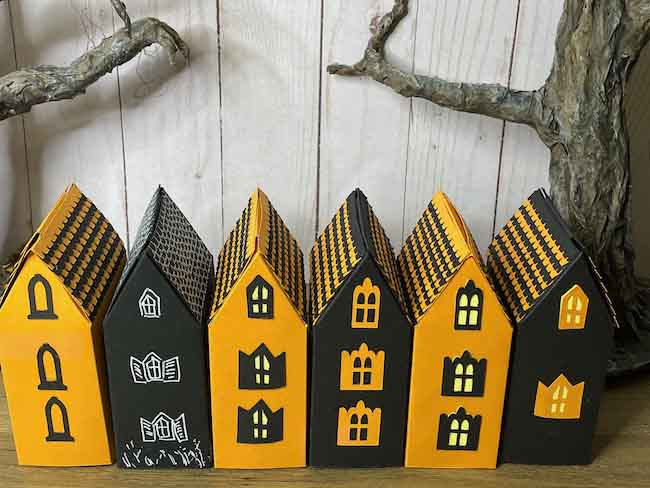 Side view of 6 Haunted Cottage candy boxes