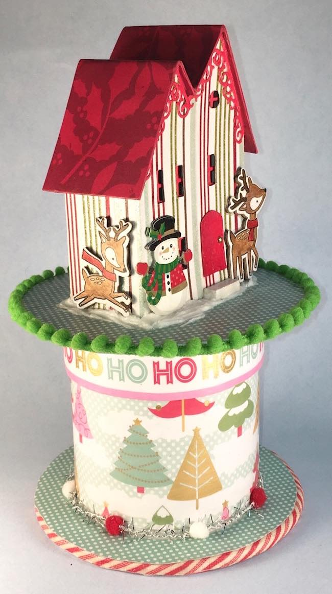 Side view of Christmas Putz house on ribbon rool