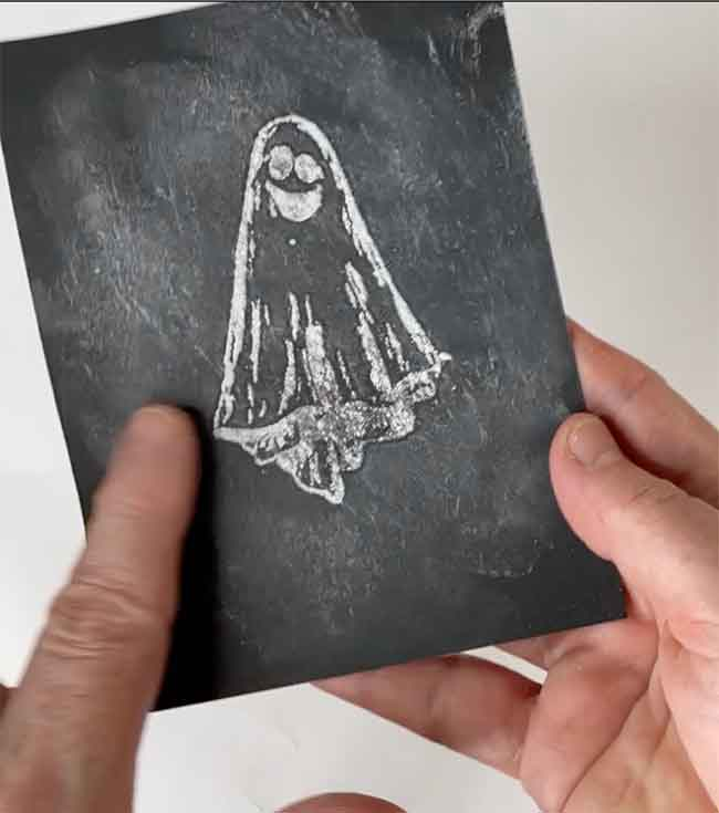 Smear the chalk on black cardstock and stamped image