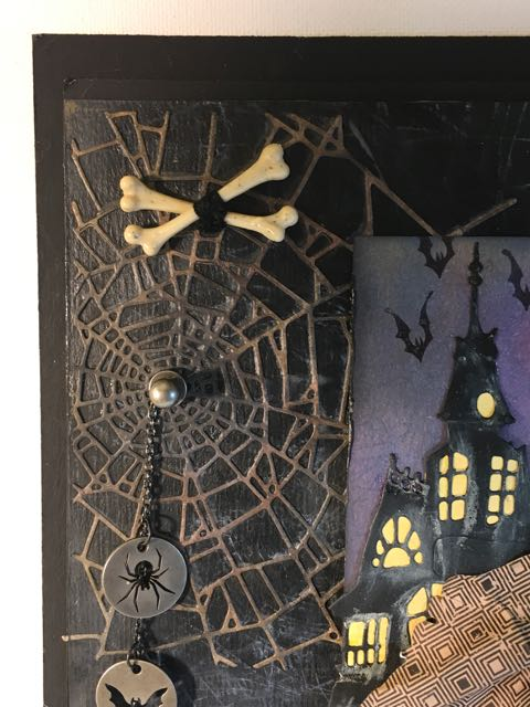 Die cut spider web in upper corner of two witches Halloween wall hanging #halloween #papercraft