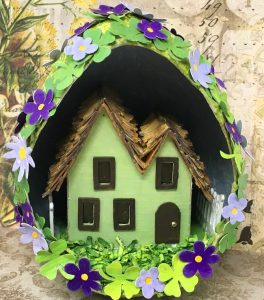 St. Patrick's Day house in paper mache egg four leaf clovers flowers