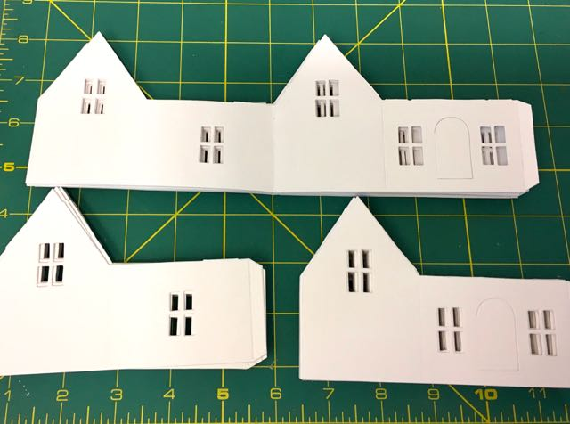 Stacks of village dwelling die cuts for unique craft party invitations