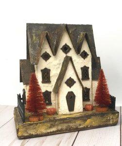 Miniature Halloween cardboard house with plaster finish